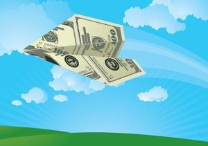 Folded US $100 bill folded into airplane flying through air