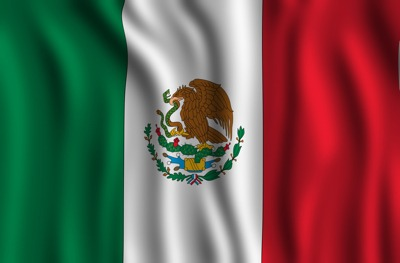 Mexican Flag - Mexico City is the seat of the Mexican Federal Government. Mexico City has so much history and culture making it a great place to visit in Mexico this winter.